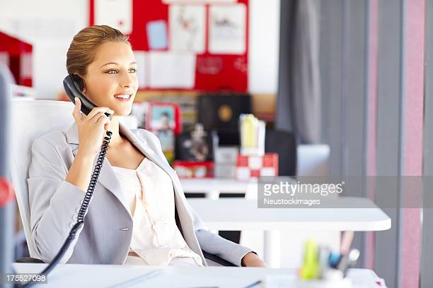 Female Professional On The Phone
