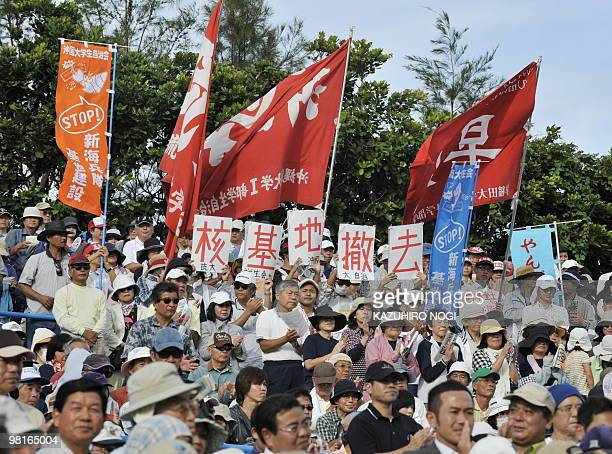 Female protesters hold placards reading 'Remove Nuclear Base' as they stage a rally against the US military base in Ginowan Okinawa Prefecture on...