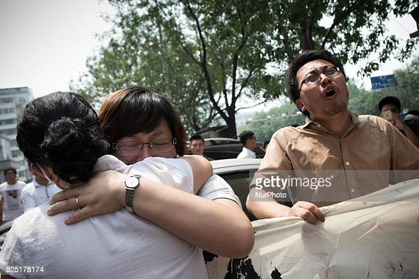 2 female protests comfort each other while a male protester chanting for justice Hundreds of residents from near the chemical explosion zone of...