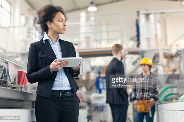 Female quality control inspector using tablet pc