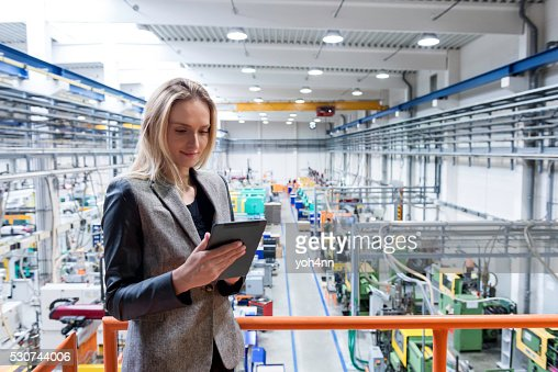 Female quality inspector using tablet