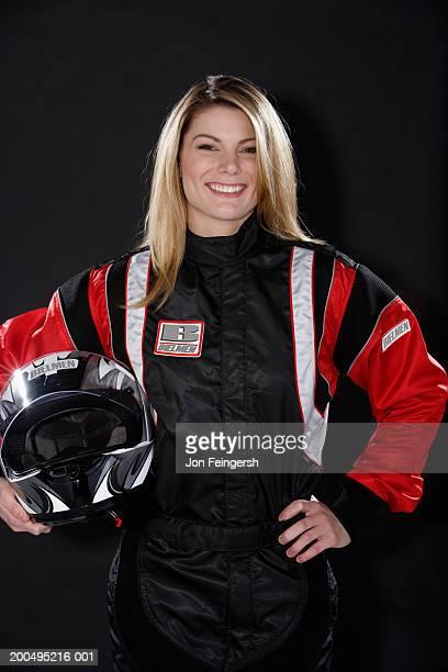 Female race car driver with helmet, portrait
