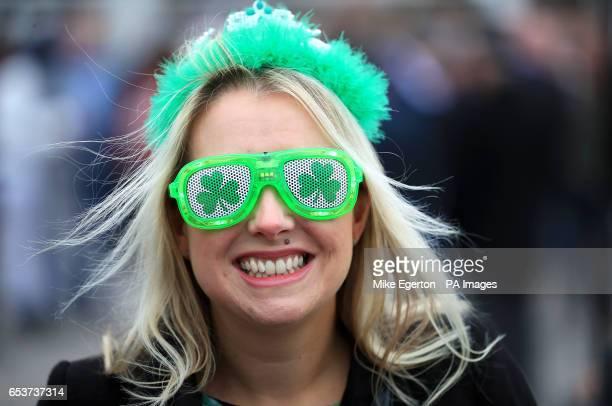 A female racegoer in Irish themed novelty glasses during St Patrick's Thursday of the 2017 Cheltenham Festival at Cheltenham Racecourse