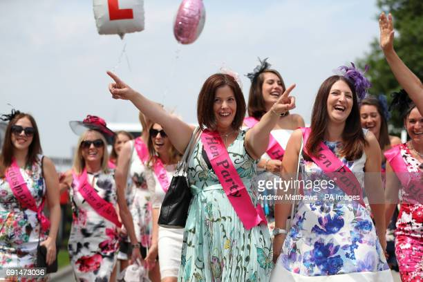Female racegoers arrive for a hen party on Ladies Day during the 2017 Investec Epsom Derby Festival at Epsom Racecourse Epsom