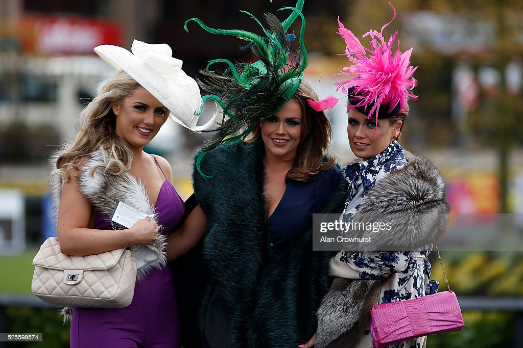 Female racegoers pose for a photo at Punchestown racecourse on April 28, 2016 in Naas, Ireland.