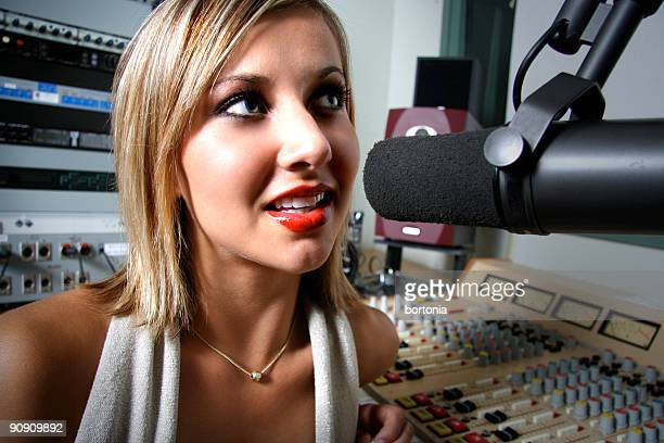 Female radio DJ at the mic