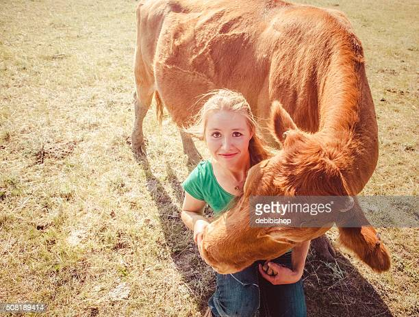 Female Rancher Woman And Red Angus Cow