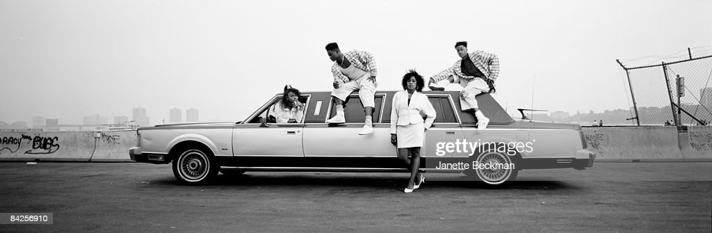 Female rapper Antoinette from Queens poses outside a stretch limousine with supporting members of her act, 1989. New York.