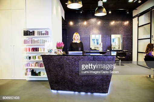 Female receptionist in hair salon stock photo getty images for Hair salon perfect first essential