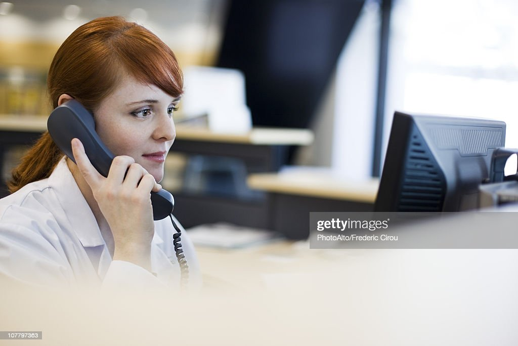 Female receptionist talking on phone