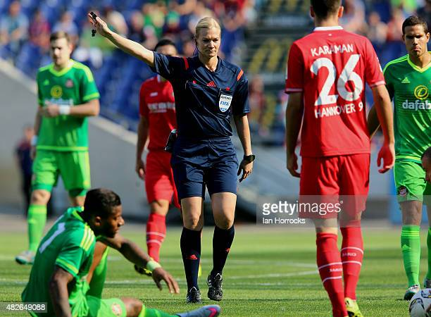 Female referee Bibiana Steinhaus gives a decision during a PreSeason friendly match between Hannover 96 and Sunderland AFC at the HDI Arena on August...