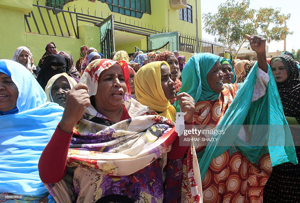 Female relatives and supporters of Sudan's Brigadier Mohammed Ibrahim cheer as he arrives home after being released along with six other military officers convicted and jailed over a coup attempt on April 17, 2013, in Khartoum. The seven Sudanese military officers convicted and jailed over a coup attempt walked free, just days after they were sentenced, an AFP reporter witnessed. AFP PHOTO/ASHRAF SHAZLY