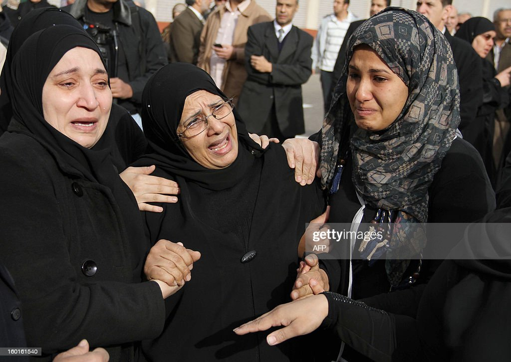 Female relatives grieve during the funeral of two policemen in Cairo, on January 27, 2013. The two were among 31 people killed on January 26 in the canal city of Port Said in clashes with police after a Cairo court handed down death sentences on 21 supporters of Port Said's Al-Masry football club who were accused of the 2012 football riots that left 74 mainly supporters of Cairo's Al-Ahly football club dead. AFP PHOTO/ AHMED MAHMOUD