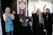 Female relatives of Palestinian football player Mahmud Sarsak who staged a hunger strike of nearly three months while in Israeli jail sing as they...