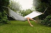 Female relaxing in hammock