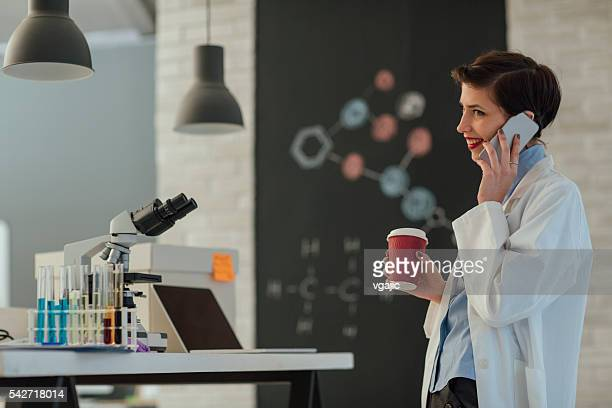 Female Researcher Working In Her Lab.