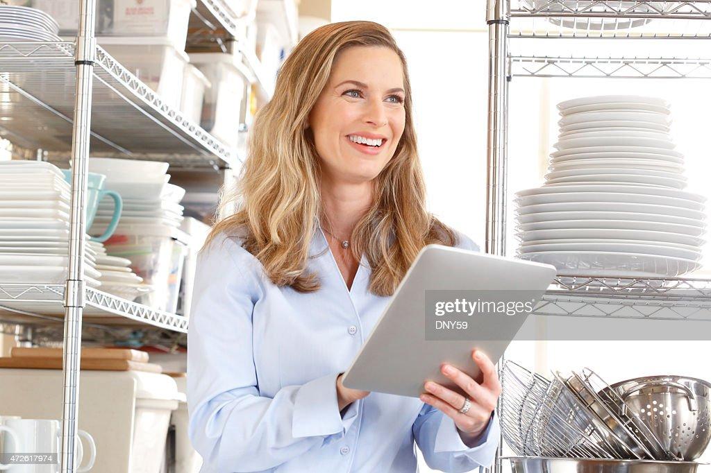 Female restaurant owner works on her digital tablet