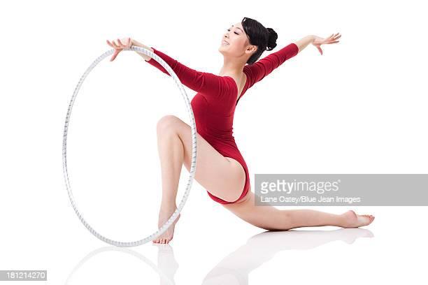 Female rhythmic gymnast performing with hoop