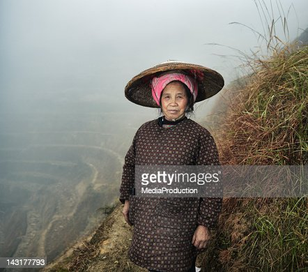 Female Rice Farmer on paddy fields : Stock Photo
