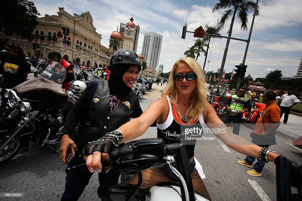 Female riders from different countries join the bike parade in the heart of the city on September 16, 2013 in Kuala Lumpur, Malaysia. Malaysia hosts Asia Harley Days, a first of its kind event in Southeast Asia to engage with not only its consumers, but also with their fans in the region.