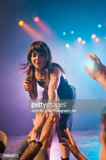 Female Rock Star On Stage Interacting With Audience Stock ...