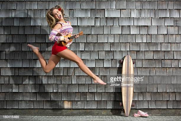 Female rocking out on her ukulele.