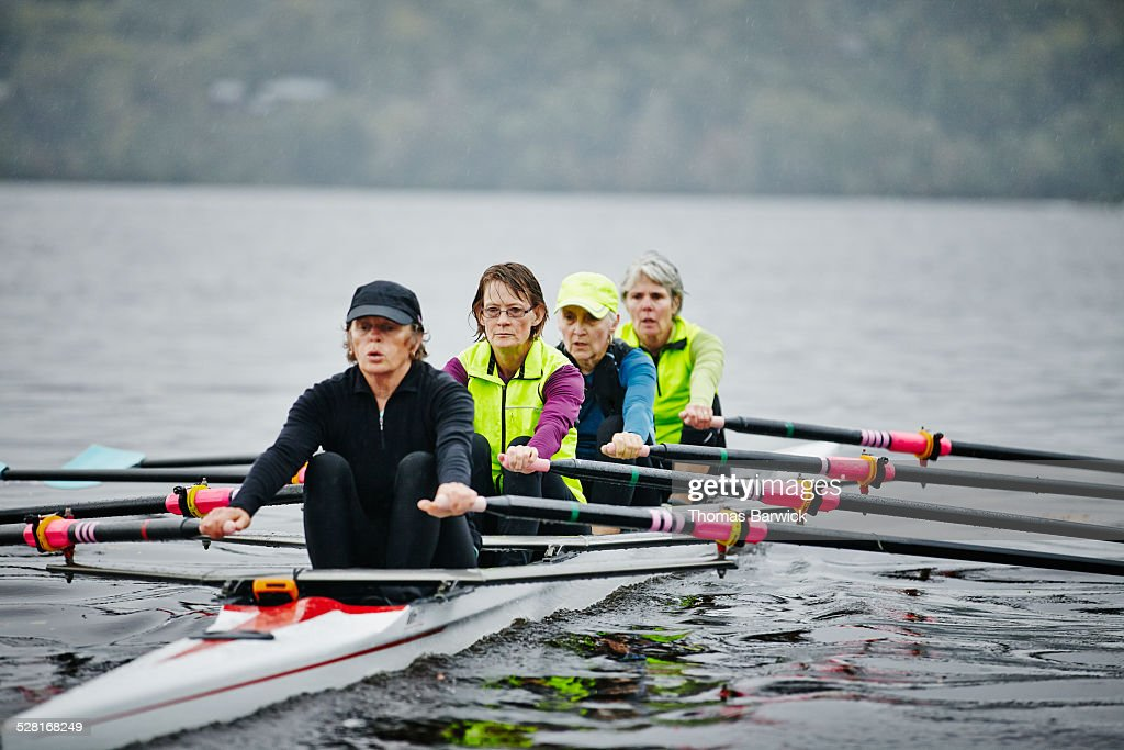 Female rowers practicing on rainy morning