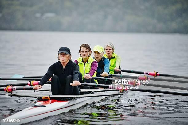 Female rowers practicing on rainy morning