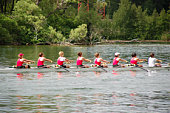 Female rowing team competing in a race.