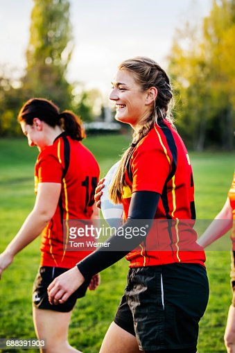 Female Rugby Player On Field