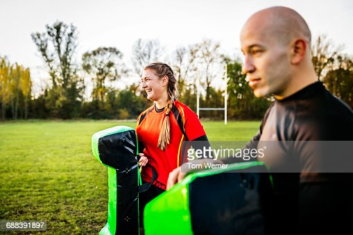 Female Rugby Player With Trainier