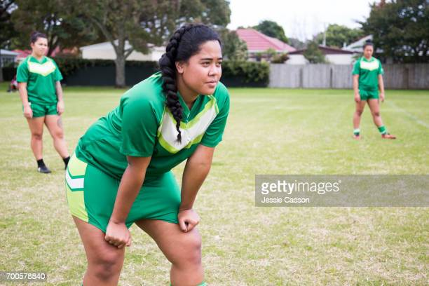 Female rugby players on field waiting for ball
