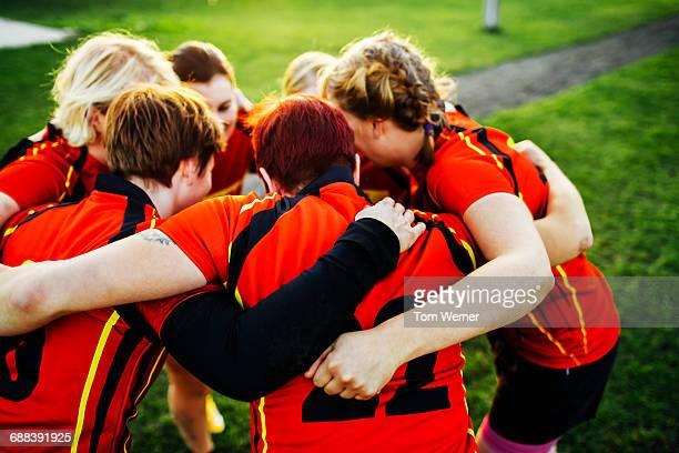Female Rugby Team Showing Team Spirit