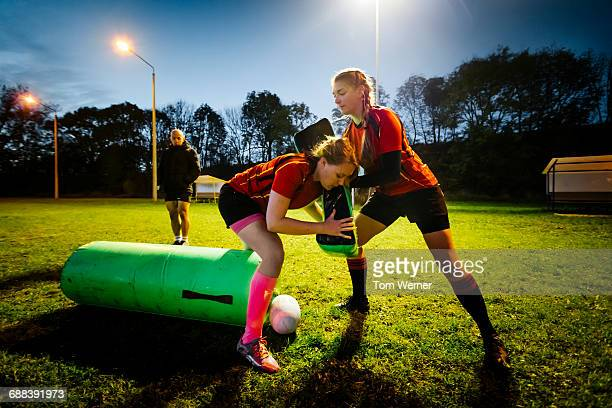 Female rugby training in the evening