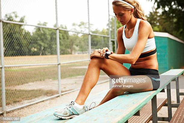 Female runner checking time on wristwatch