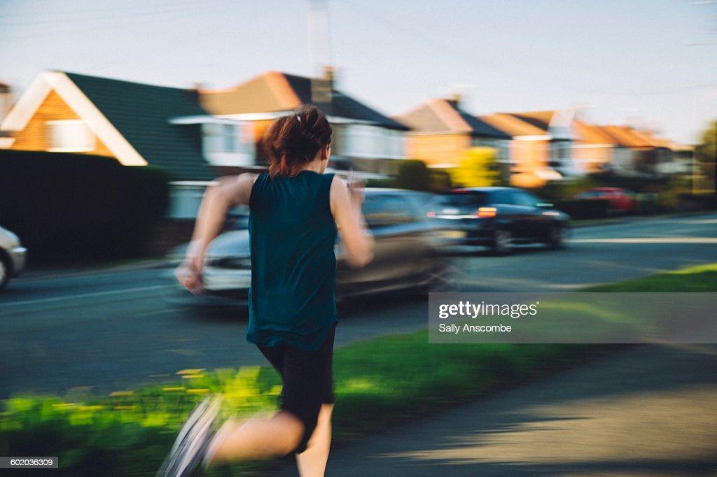 Female runner on a busy street