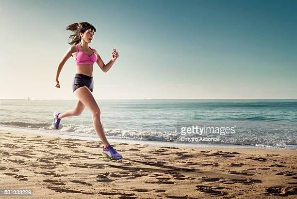 Female runner on a sea shore