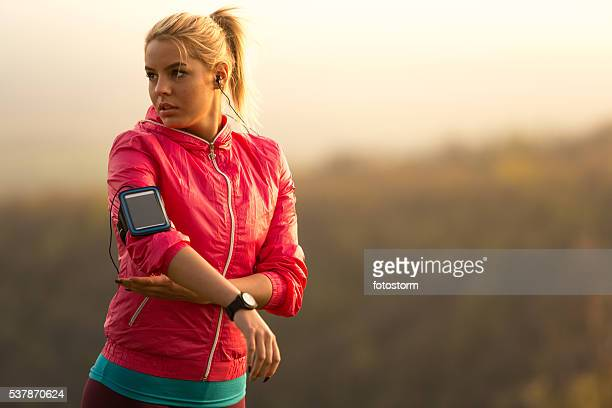 Female runner preparing for exercising