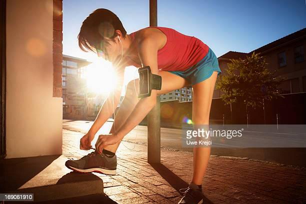 Female runner preparing in urban environment
