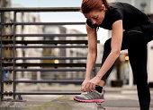 female runner preparing