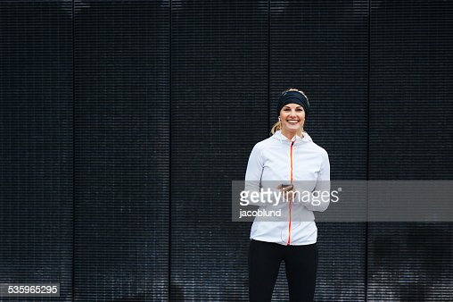 Female runner relaxing after a training session : Stock Photo