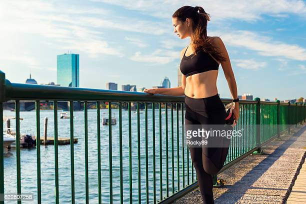 Female Runner Stretching While Enjoying the View in Boston, USA