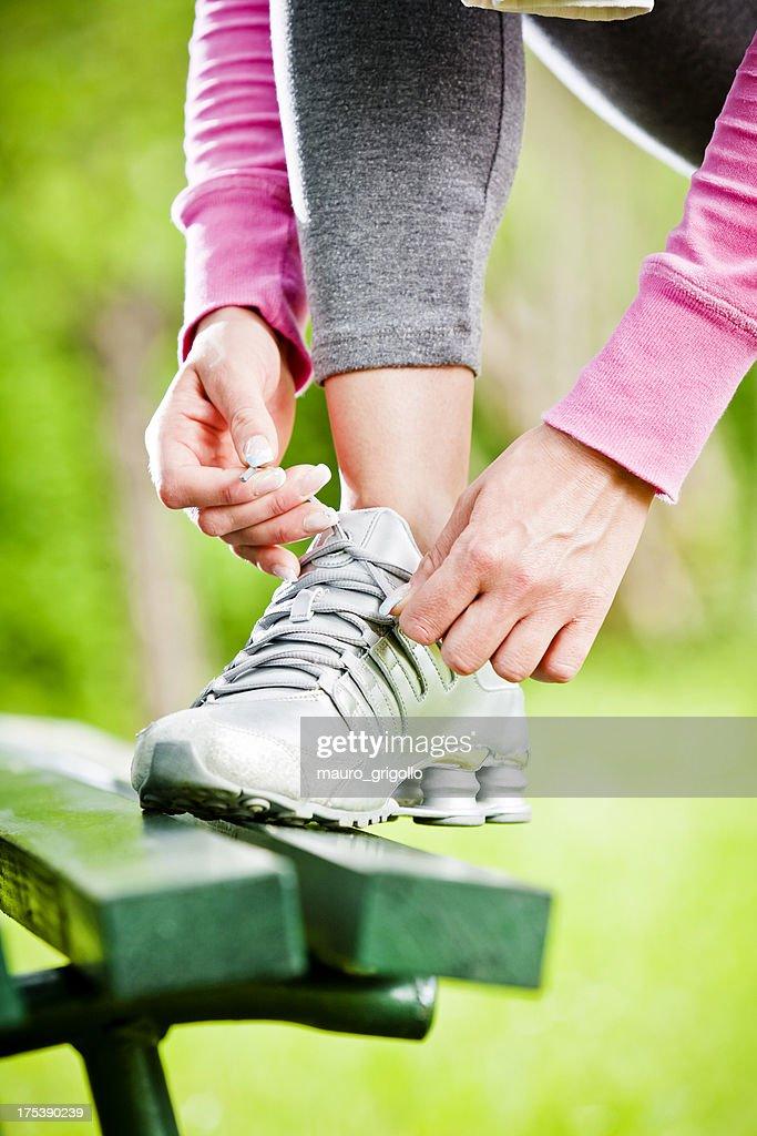 Female runner tying her shoelace outdoor