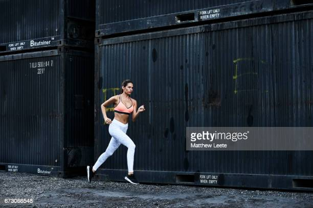female runner with cargo containers in background