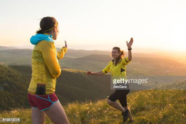 Female runners celebrating their acomplishment with a high five