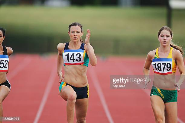 Female Runners On Racetrack