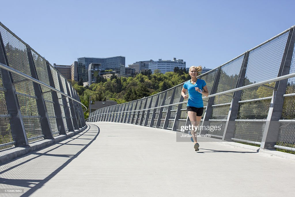 A female running in the city. : Stock Photo