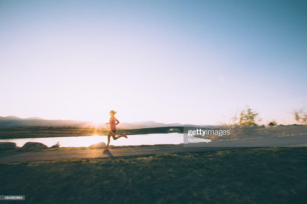 Female Running on Path During Sunset in Utah : Stock Photo