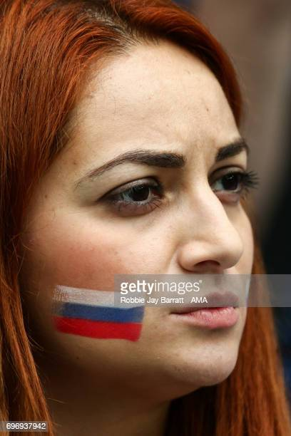 Female Russian fan with face paint on during the Group A FIFA Confederations Cup Russia 2017 match between Russia and New Zealand at Saint Petersburg...