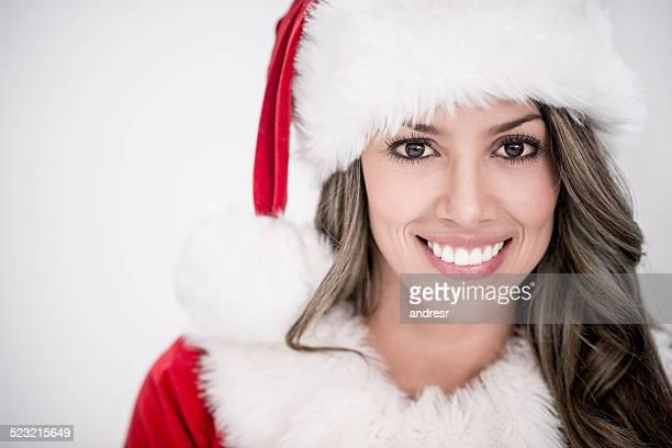 Female Santa looking happy